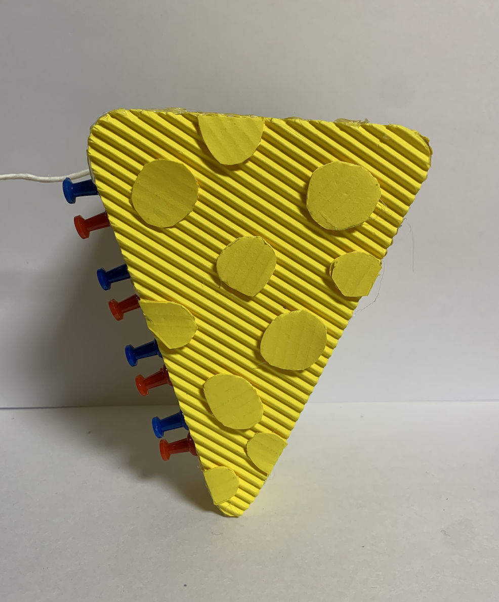 A front view of the sensor unit crafted prototype (cheese shape for entertainment)